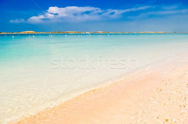 Magiczny plaży wody Błękitne niebo żółty piasku Zdjęcia stock © vlaru