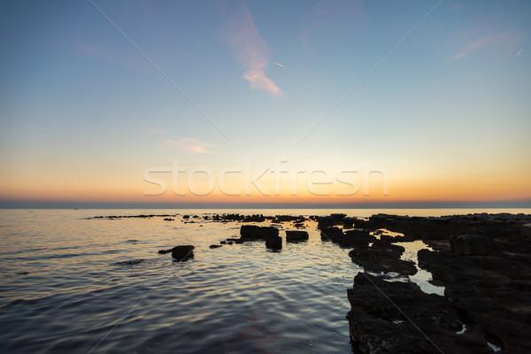 gorgeous sunset on the rocky coast of Adriatic Stock photo © vlaru