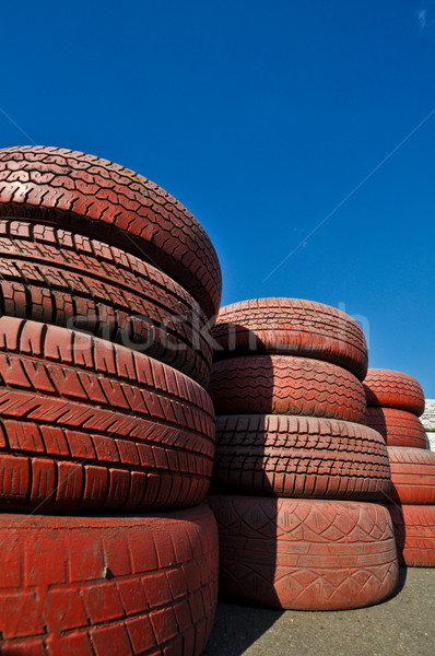 close up of racetrack fence of  red old tires Stock photo © vlaru