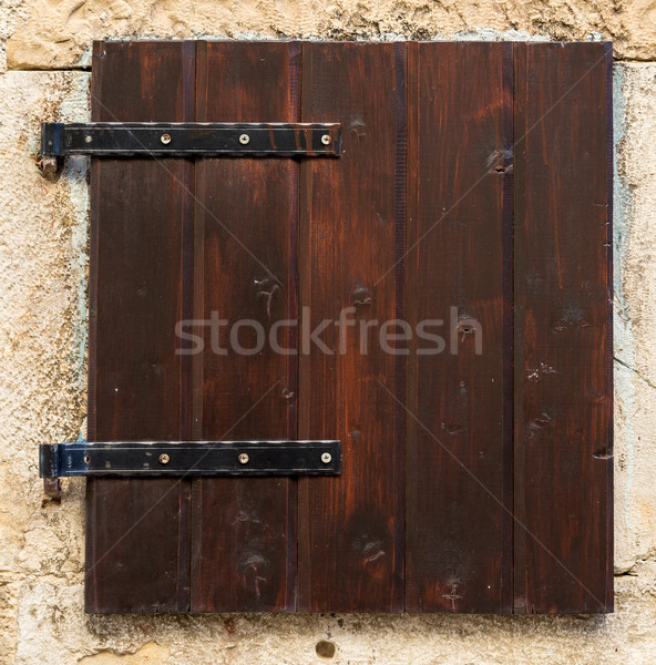 old window with  closed brown  wooden shutters Stock photo © vlaru