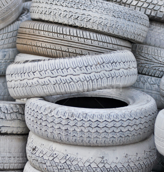 close-up. the white automobile tires dumped in a a big pile Stock photo © vlaru