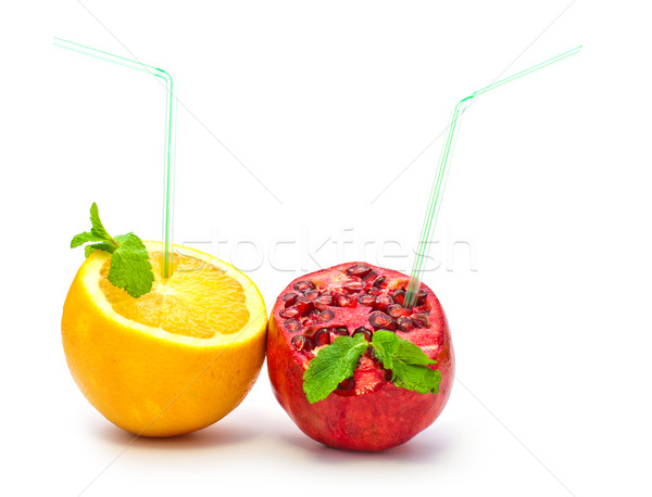 orange and pomegranate with a straw on a white background Stock photo © vlaru