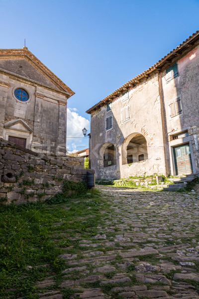 cobbled pavement and stone buildings Stock photo © vlaru