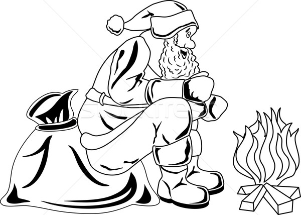 Stock photo: Santa Claus sits by the fire