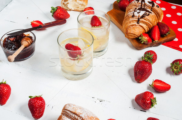 fresh croissants with lemonade and strawberries on white wooden background Stock photo © voloshin311