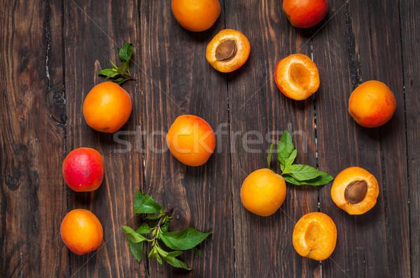 apricots on dark wood background Stock photo © voloshin311