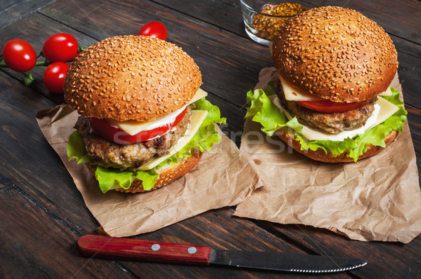 Fresh burger closeup on rustic wooden table Stock photo © voloshin311