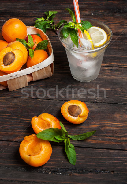 Cold fresh lemonade and apricots on wood background Stock photo © voloshin311