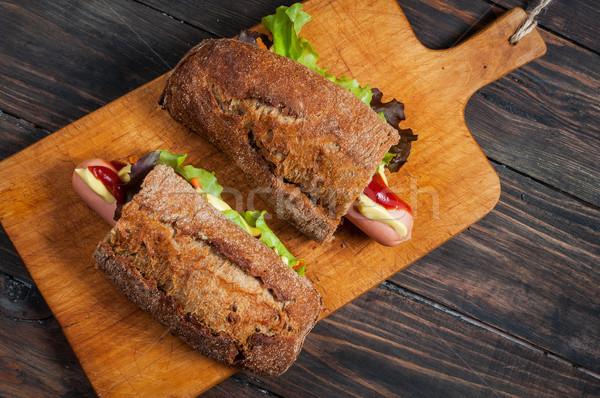 Ev yapımı sosisli sandviç rustik ahşap ketçap hardal Stok fotoğraf © voloshin311