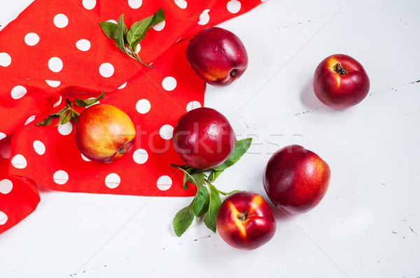nectarines on white wooden table. Close up Stock photo © voloshin311