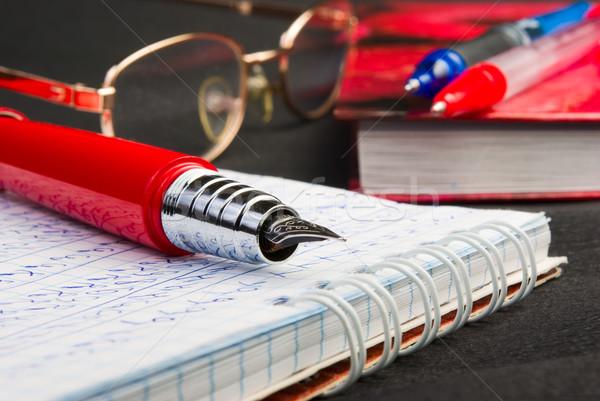 Nosso caneta vermelho papel livro educação Foto stock © vrvalerian