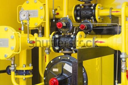 Amarelo posto de gasolina distribuição construção tecnologia fábrica Foto stock © vrvalerian