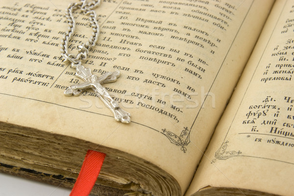 Old bible and silver cross Stock photo © vtorous