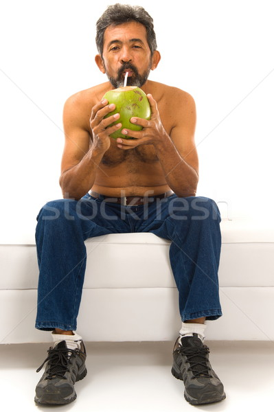 Drinken kokosnoot water man drinken witte Stockfoto © vtupinamba