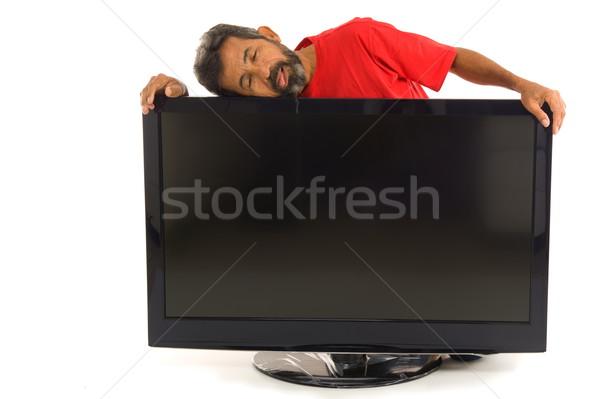 Tired man and the Tv Stock photo © vtupinamba