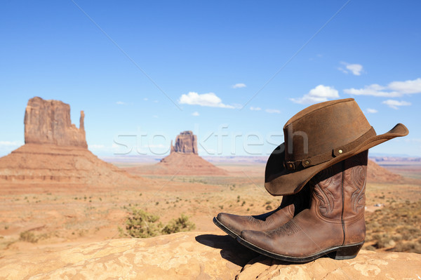 cowboy boots and hat in front of Monument Valley Stock photo © vwalakte