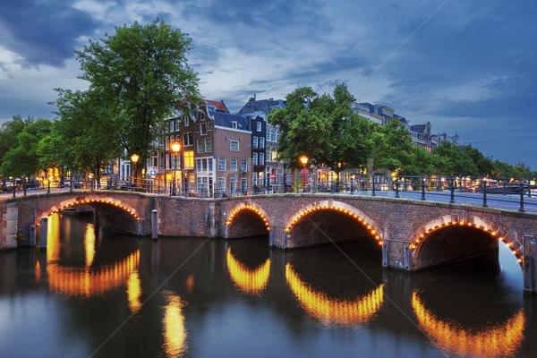Amsterdam kanał zmierzch świetle wody pomarańczowy Zdjęcia stock © vwalakte