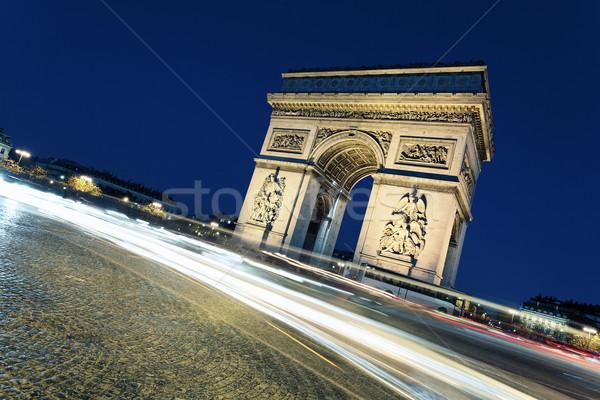 Триумфальная арка ночь автомобилей фары Париж закат Сток-фото © vwalakte