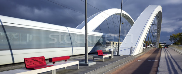 Tramway crossing a bridge Stock photo © vwalakte