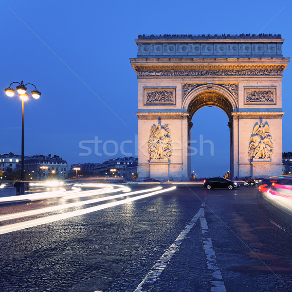 Famoso Arco do Triunfo noite ver Paris pôr do sol Foto stock © vwalakte