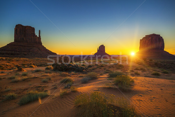 Horizontal view of sunrise at Monument Valley Stock photo © vwalakte