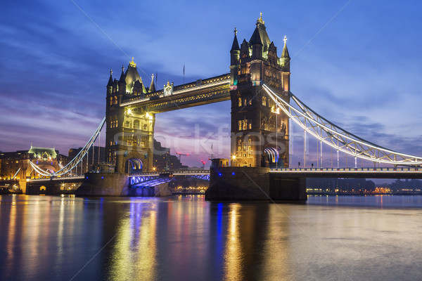 Famous Tower Bridge in the evening Stock photo © vwalakte