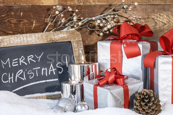 gifts with lighted candles Stock photo © vwalakte