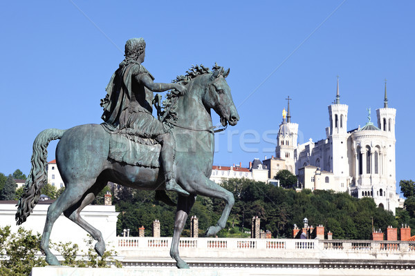 famous statue of Louis XIV and Basilique Fourviere Stock photo © vwalakte