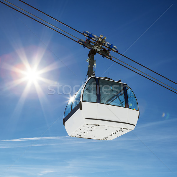 Cable car and sun Stock photo © vwalakte
