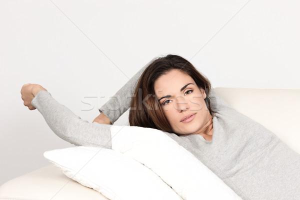 Beautyful woman relaxing on sofa Stock photo © vwalakte