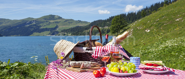 Picnic in french alps with lake  Stock photo © vwalakte