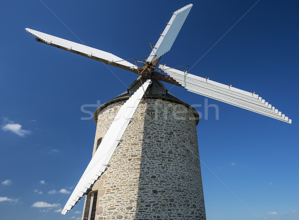 Windmill in blue sky Stock photo © vwalakte