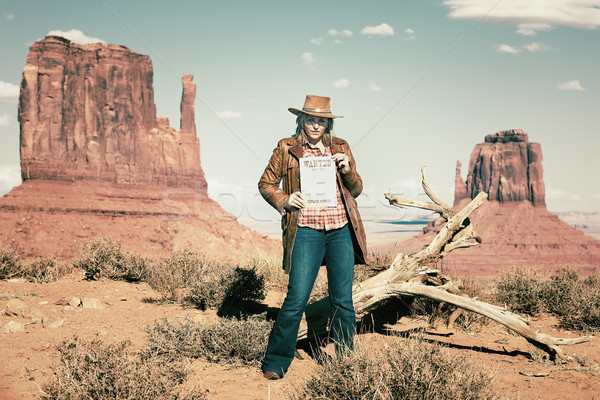 blond cowgirl holding wanted paper Stock photo © vwalakte