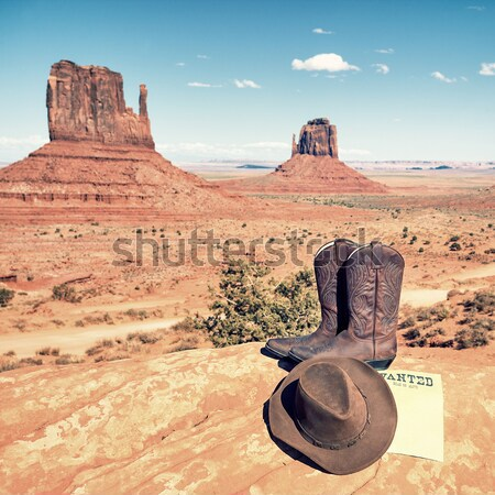 boots and hat in front of Monument Valley Stock photo © vwalakte