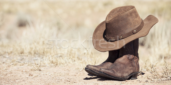 brown cowboy hat and boots outdoor Stock photo © vwalakte