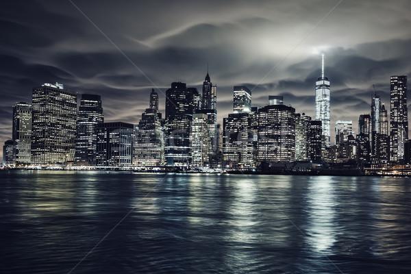 Sötét éjszaka Manhattan New York kilátás város Stock fotó © vwalakte