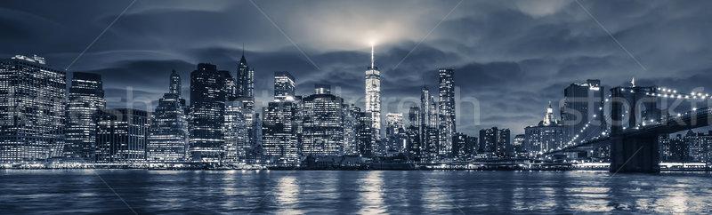 Kilátás Manhattan éjszaka New York épület kék Stock fotó © vwalakte