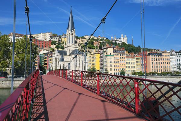 мнение Лион город красный пешеходный мост реке Сток-фото © vwalakte