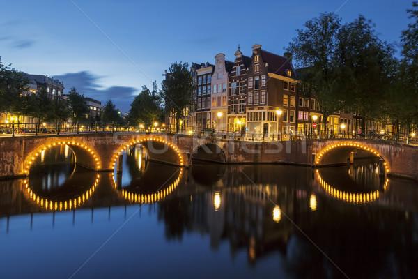 Stok fotoğraf: Amsterdam · kanal · gece · Hollanda · su · turuncu