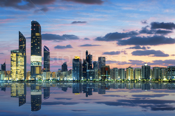 View of Abu Dhabi Skyline at sunset Stock photo © vwalakte