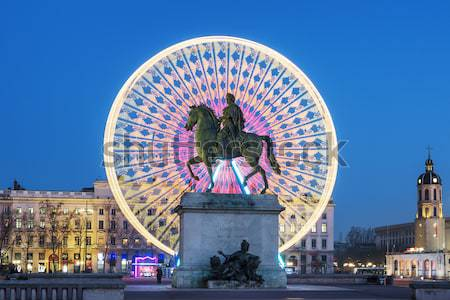 Statue of Louis XIV and wheel by night Stock photo © vwalakte