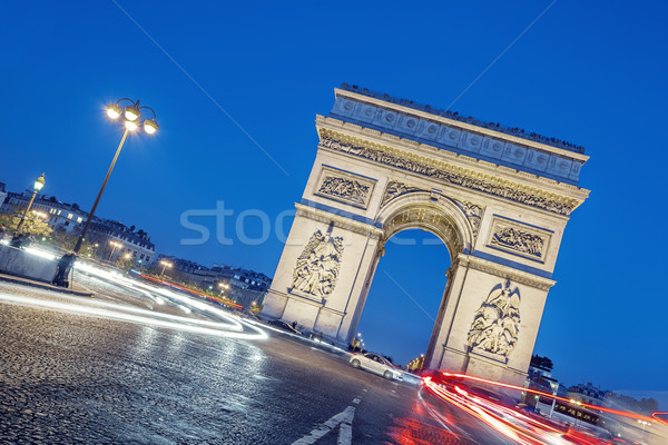 Arc de Triomphe at night. Stock photo © vwalakte