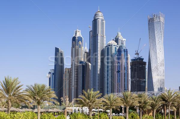 Сток-фото: Небоскребы · пальмами · Дубай · пляж · небе · зданий