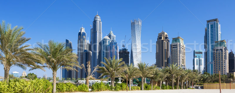 Panoramic view of skyscrapers and jumeirah beach Stock photo © vwalakte