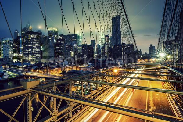 Híd éjszaka autó forgalom NY épület Stock fotó © vwalakte