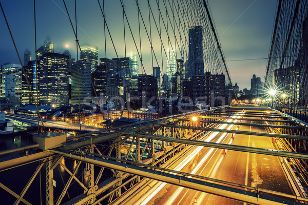 Brug nacht auto verkeer ny gebouw Stockfoto © vwalakte