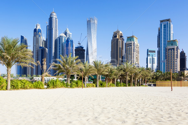 Horizontal view of skyscrapers and jumeirah beach Stock photo © vwalakte