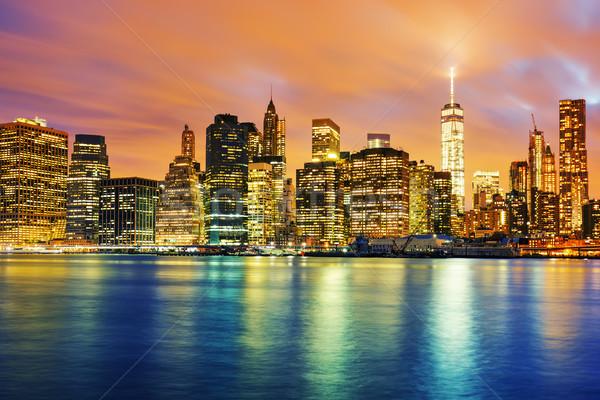Kilátás Manhattan naplemente New York épület kék Stock fotó © vwalakte