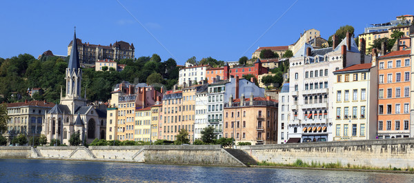 Saone river with colorful houses Stock photo © vwalakte