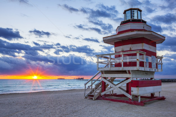 sunrise with lifeguard towe Stock photo © vwalakte